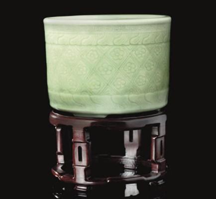 A celadon glazed tripod jardin