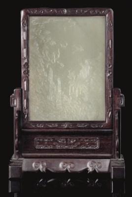 A pale celadon jade table scre