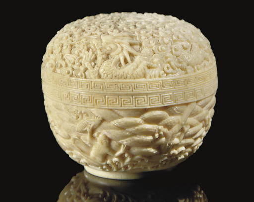 An ivory domed box and cover,
