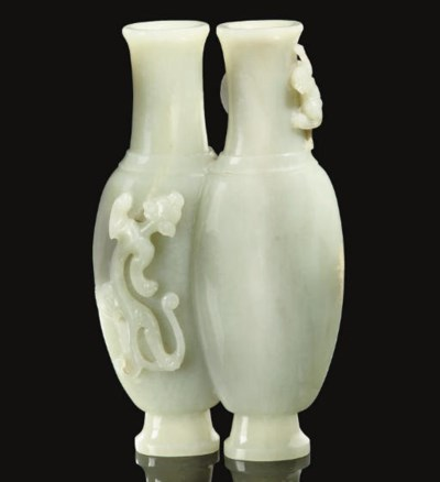 A pale celadon jade conjoined