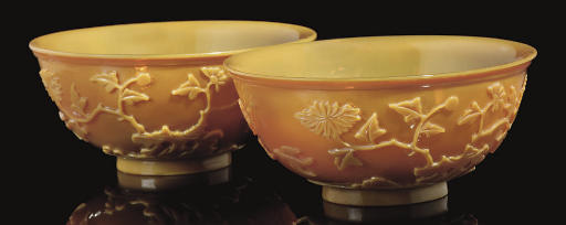 A pair of carved yellow glass