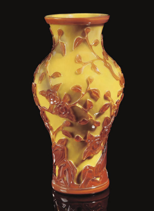 An overlay glass baluster vase