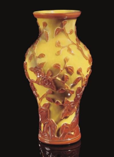 An overlay glass baluster vase