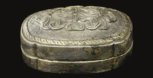 A small parcel-gilt silver box