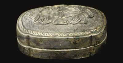 A small parcel-gilt silver box