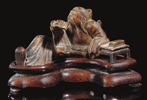 A Bamboo carving of a seated f