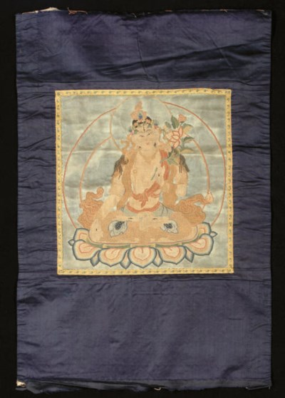 AN EMBROIDERED GUANYIN, 19TH C
