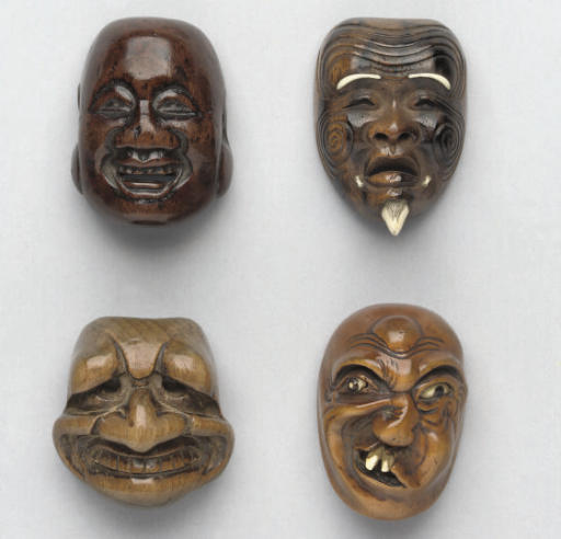 A group of four Japanese wood