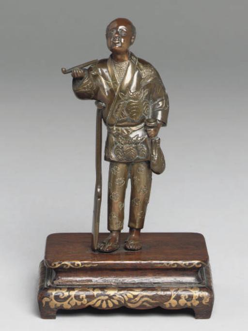 A Japanese bronze figure, sign
