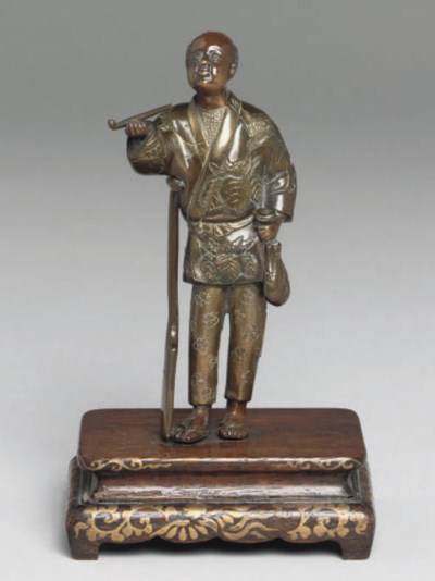 A Japanese bronze figure, sign