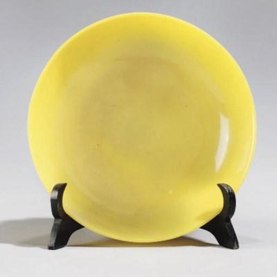 A Beijing yellow glass saucer-