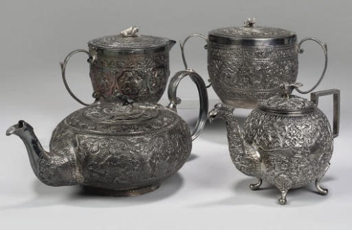 A small group of repousse silv