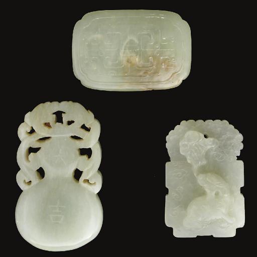 A Chinese pale celadon jade bu
