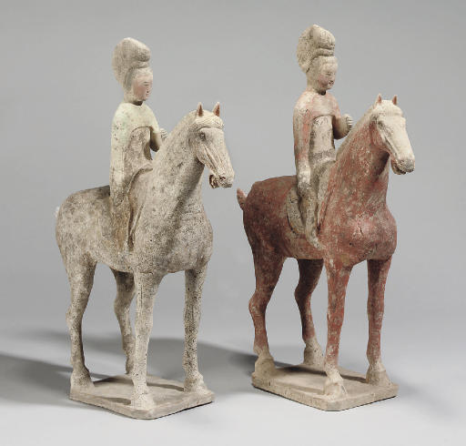 A pair of Chinese painted pottery horses with lady riders, Tang Dynasty (618-906)
