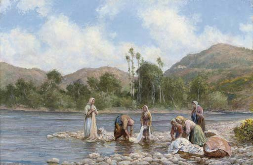 Women washing clothes on a river bank
