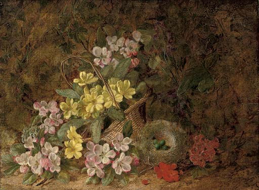 Hawthorn blossom, primroses and a bird's nest on a mossy bank