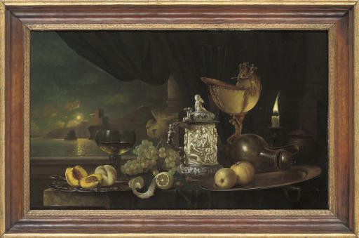 Peaches on a silver platter, with a römer, grapes, lemon, silver mounted ivory tankard, jug and a candle, on a stone ledge, a moonlit seascape beyond