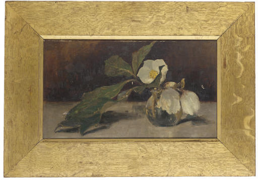 Magnolias in a glass vase, on a table