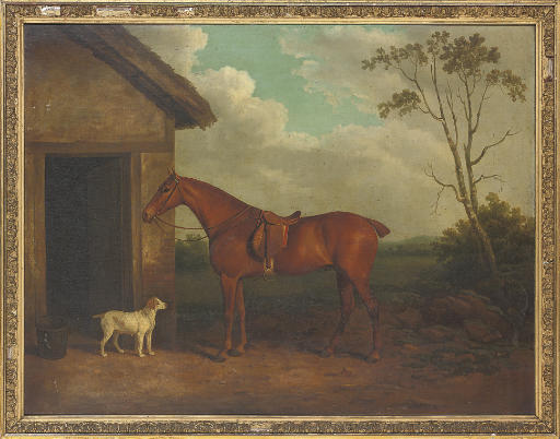 A chestnut hunter and hound outside a stable
