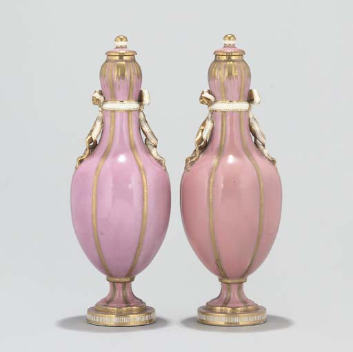 A PAIR OF MINTON VASES AND COVERS AND A PAIR OF PARIS BOTTLE VASES