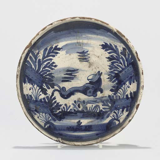 A CATALONIAN FAIENCE BLUE AND WHITE TAZZA