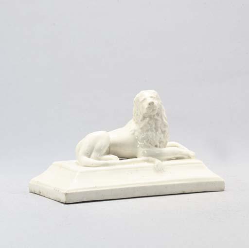A VINOVO WHITE MODEL OF A LION