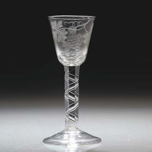 AN ENGRAVED FACETED WINE-GLASS