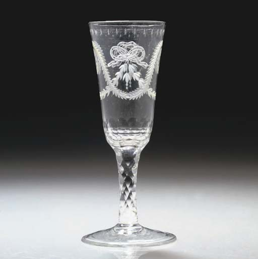 AN ENGRAVED FACET-STEMMED ALE-