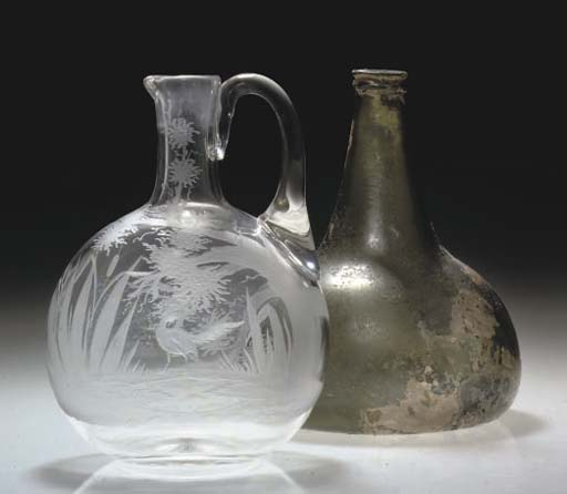 A WINE-BOTTLE AND AN ENGRAVED