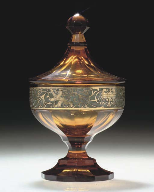 AN AMBER GLASS JAR AND COVER