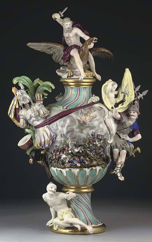 A MEISSEN SPIRALLY-MOULDED FIGURAL VASE AND COVER EMBLEMATIC OF WAR