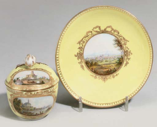 A MEISSEN YELLOW-GROUND TOPOGRAPHICAL CUP, COVER AND STAND