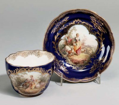 A MEISSEN BLUE GROUND TEACUP A