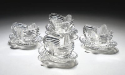 A SET OF FOUR CUT-GLASS ANGLO-
