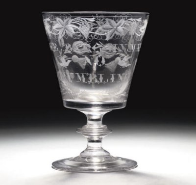 AN ENGRAVED GLASS RUMMER