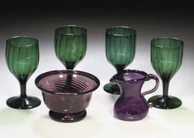 A SET OF ELEVEN GREEN GLASS GO