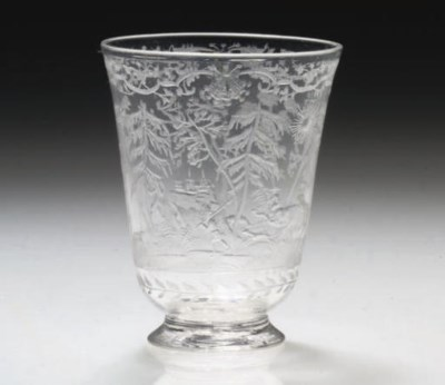 AN ENGRAVED BELL-BOWLED FOOTED