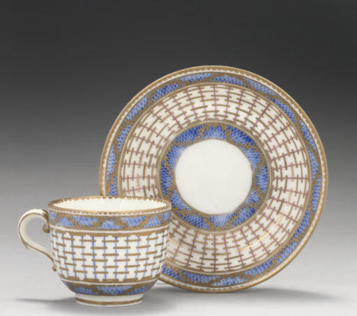 A SEVRES MINIATURE COFFEE-CUP