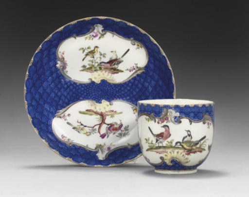 A MEISSEN ORNITHOLOGICAL BLUE-SCALE-GROUND COFFEE CUP AND SAUCER