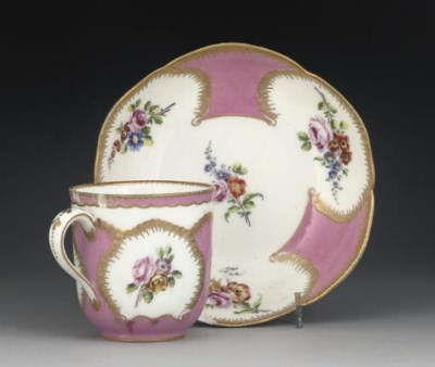 A SEVRES PINK-GROUND CUP AND S