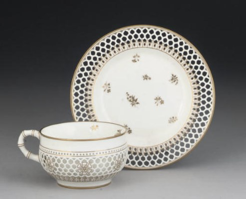 A SEVRES RETICULATED TEACUP AN