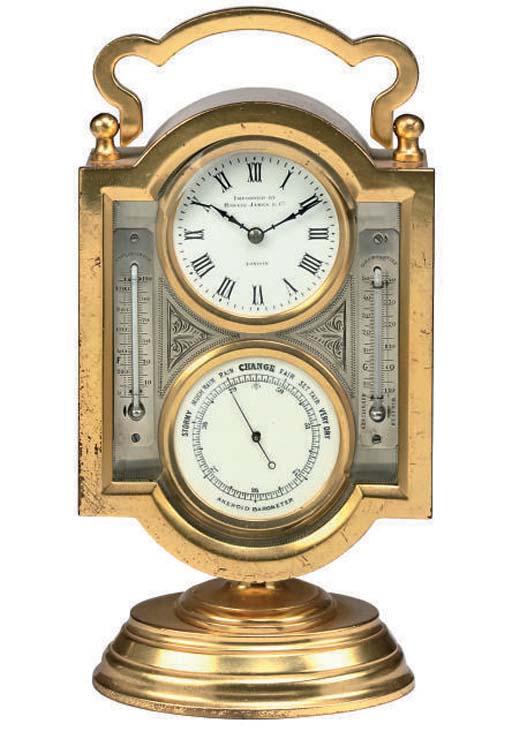 A French gilt-brass eight day timepiece desk compendium