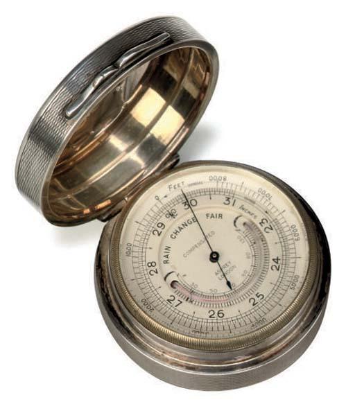 A silver pocket barometer