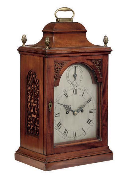A George III style mahogany an