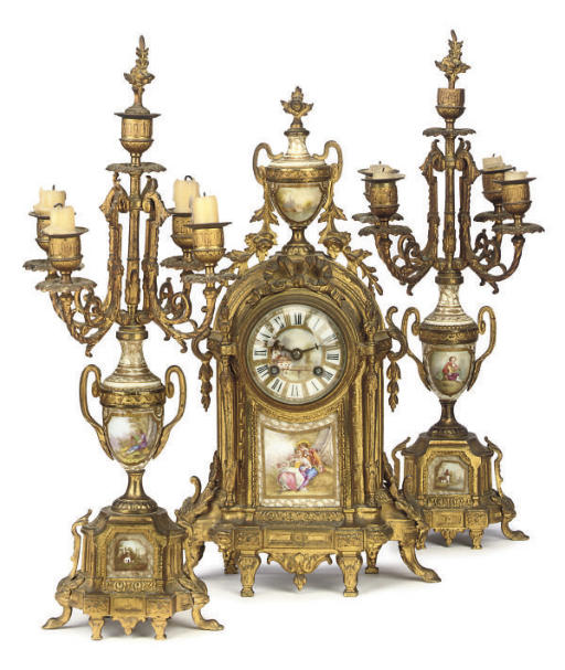 A French gilt-metal and porcelain-mounted eight day striking mantel clock and garniture