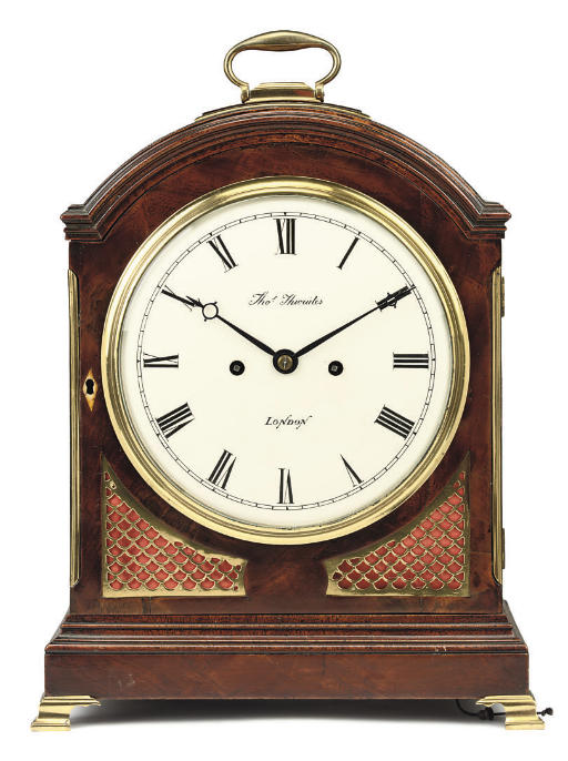 A George III mahogany and brass-mounted eight day striking table clock