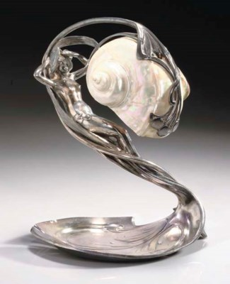 A SILVERED METAL AND SHELL FIG