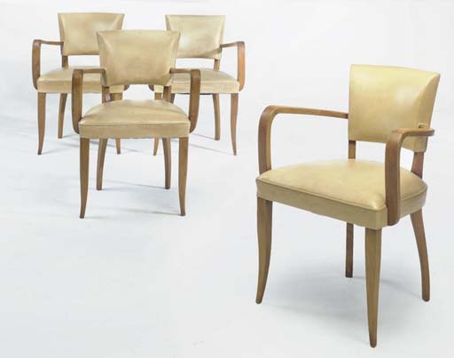 A SET OF FOUR UPHOLSTERED WOOD