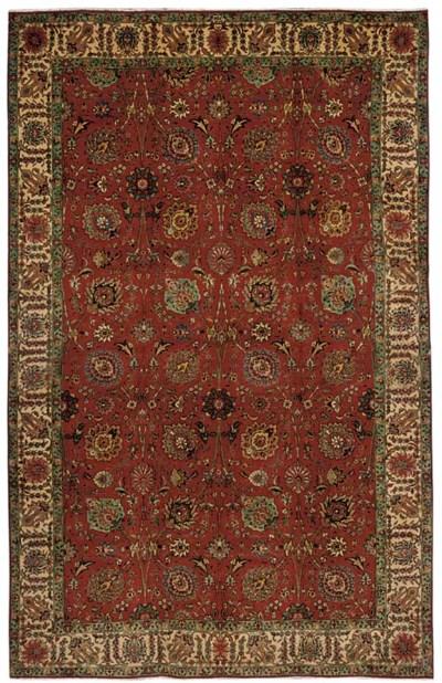 A fine Amir Khis Tabriz carpet