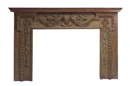 A CARVED PINE CHIMNEYPIECE